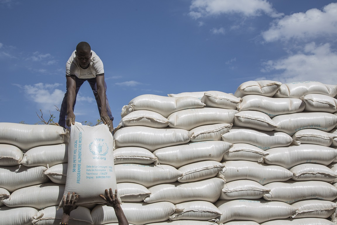 Workers offloading flour at a WFP warehouse in Kaya, north of Ouagadougou, Burkina Faso - WFP/Marwa Awad