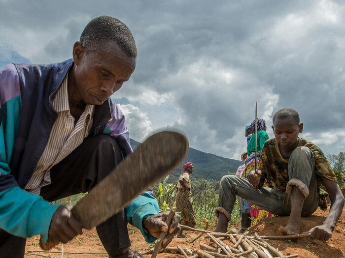 community working on land